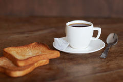 A cup of coffee and toast. A cup of coffee and toast on an old wooden table Stock Images