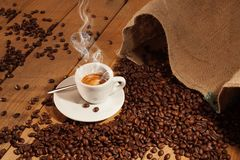 Cup of coffee with toasted beans, still life. Cup of coffee with toasted beans Royalty Free Stock Image