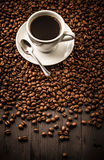 Cup of coffee top view on beans background Stock Photography