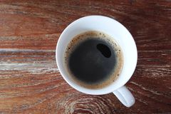 A cup of coffee. Top view of a cup of black coffee on wood Royalty Free Stock Photos