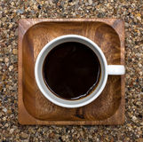 Cup of coffee top view on wooden square plate. Cup of coffee  top view, on a wooden square plate Stock Image