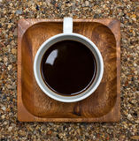 Cup of coffee top view on wooden square plate. Cup of coffee  top view, on a wooden square plate Royalty Free Stock Images