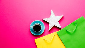 Cup of coffee, toy and shopping bags Stock Images