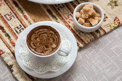 A cup of coffee on the traditional tatar tablecloth Stock Photos