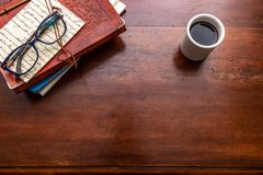 Cup of coffee and travel diaries on wooden desk. I love travel royalty free stock photo