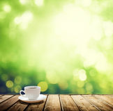 Cup coffee and trees background Royalty Free Stock Photography