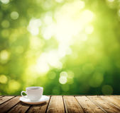Cup coffee and trees background Stock Photos