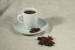 A cup of coffee and truestar anisetree. Against light background Royalty Free Stock Image