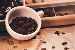 Cup of coffee and truffles in chocolate Stock Photos