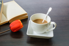 Cup of coffee with tulip and book Royalty Free Stock Image