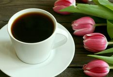 Cup of coffee and tulips Stock Photos