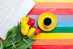 Cup of coffee with tulips and notebook Royalty Free Stock Photography