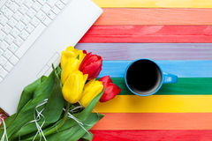 Cup of coffee with tulips and notebook Royalty Free Stock Photo