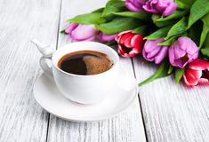 Cup of coffee with tulips Stock Image