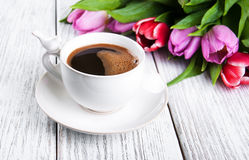Cup of coffee with tulips Stock Images
