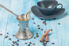 Cup of coffee, turk and coffee beans Royalty Free Stock Photos