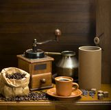 Cup of coffee, turka, coffee beans and a coffee grinder, croissants royalty free stock photography