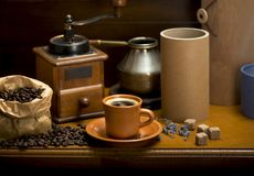 Cup of coffee, turka, coffee beans and a coffee grinder, croissants stock image