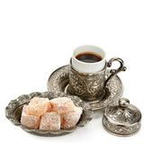 Cup of coffee and turkish delight isolated on white background. Free space for text. Cup of coffee and turkish delight in a vase isolated on white background royalty free stock photos