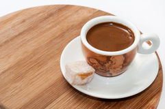 A cup of coffee and Turkish delight on a wooden board Royalty Free Stock Photography