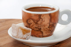 A cup of coffee and Turkish delight on a wooden board Stock Photography
