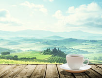 Cup coffee and tuscany hills Royalty Free Stock Photo