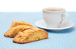 The  cup of coffee with two biscotti Royalty Free Stock Images