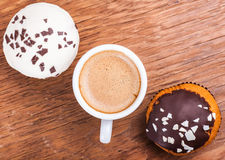 Cup of coffee and two cupcakes Stock Photography