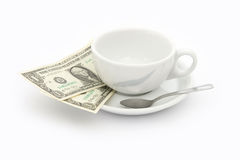 Cup of coffee with two dollars tip. White, empty cup of coffee with two dollars tip stock image