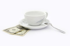Cup of coffee with two dollars tip. White, empty cup of coffee with two dollars tip under saucer stock images