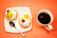 Cup of coffee and two fruit cake Royalty Free Stock Image