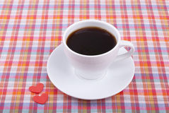 Cup of coffee and two hearts. Royalty Free Stock Photo