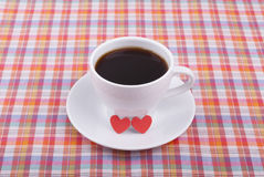 Cup of coffee and two hearts. Stock Image