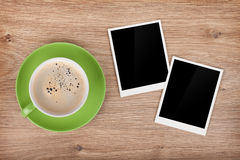 Cup of coffee and two photo frames Stock Image