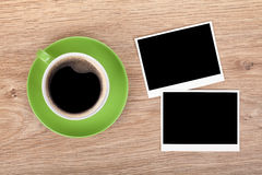 Cup of coffee and two photo frames Royalty Free Stock Photos