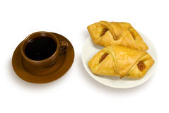 Cup of coffee and two pies on a plate. Cup of coffee and two puff pies on a white plate. On a white background Stock Image