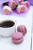 Cup of coffee and two pink macaroons Stock Image