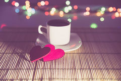 Cup of coffee and two red hearts Royalty Free Stock Images
