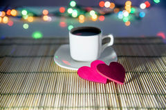 Cup of coffee and two red hearts Stock Image