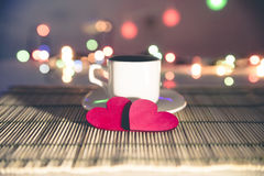 Cup of coffee and two red hearts Stock Photo