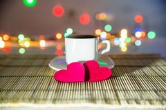 Cup of coffee and two red hearts Royalty Free Stock Image