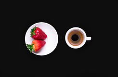 Cup of coffee and two strawberries. On black background vector illustration