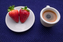 Cup of coffee and two strawberries. On blue background. texture royalty free illustration
