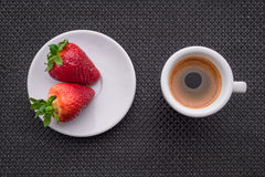 Cup of coffee and two strawberries. On brown background. texture royalty free illustration