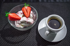 Cup of coffee and two strawberries in icecream. Cup of coffee and two strawberries with icecream in transparent plate on black background. Texture vector illustration