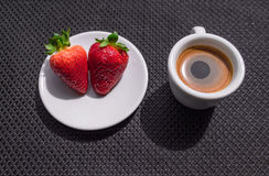 Cup of coffee and two strawberries. Cup of coffee and a strawberry on black background. Texture vector illustration