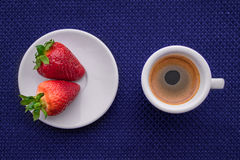 Cup of coffee and two strawberries. Cup of coffee and a strawberry on deep blue background. Texture stock illustration