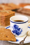 Cup of coffee with a typical Dutch speculaas cookie Royalty Free Stock Photography