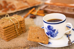 Cup of coffee with a typical Dutch speculaas cookie Stock Image