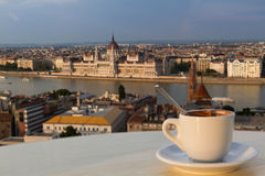 Cup of coffee with a view of the parliament building in Budapest Royalty Free Stock Photos